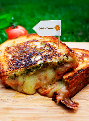 Grilled cheese sandwich with golden brown flag