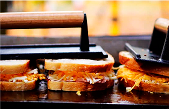 grilled cheese sandwiches being grilled
